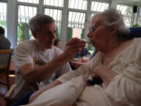 My brother feeding my mother